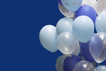colorful balloons on blue background. happy new year and happy birthday concept 스톡 콘텐츠