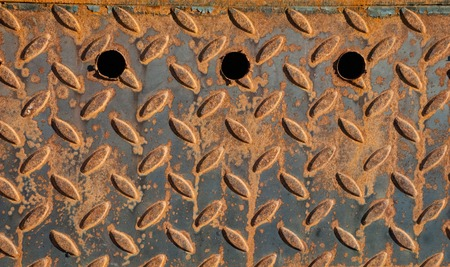 oxidate: texture of fluted rusty iron metal plate background