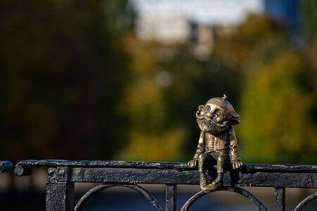 Kaliningrad, Russia - 5th of october 2019: Bronze miniature sculpture of the grandfather homlin on the honey bridge Редакционное