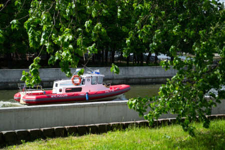 Kaliningrad / Russia, 05/16/2020: Red and white patrol boat EMERCOM of Russia, state inspection of small vessels on duty on the river in the city