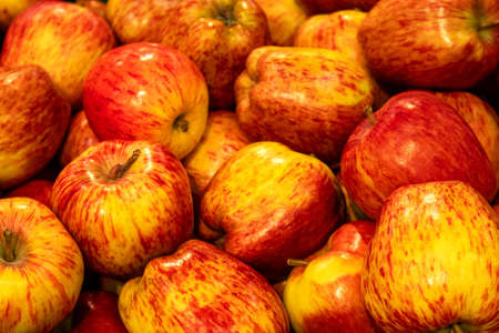 red and yellow apples closeup background
