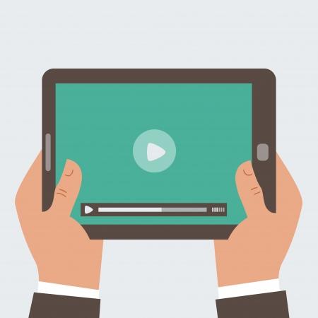 사업가 인간의 손에 화면에 비디오 플레이어와 함께 태블릿 컴퓨터를 들고,