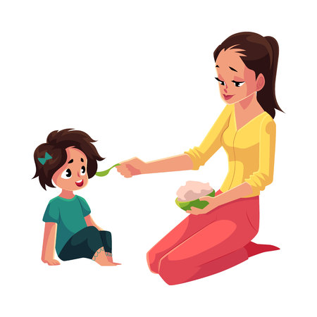Mother spoon feeding her little daughter sitting on the floor, cartoon vector illustration isolated on white background. Mother, mom holding bowl of porridge, feeding her daughter sitting on the floor Illustration