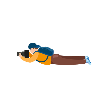 vector flat cartoon man in outdoor clothing wearing cap, backpack lying at ground with photo camera making shoots. Isolated illustration on a white background.
