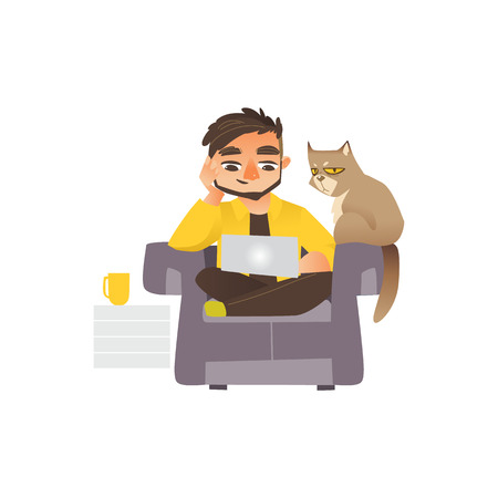 Young man sitting on sofa with laptop and cat, distance working.