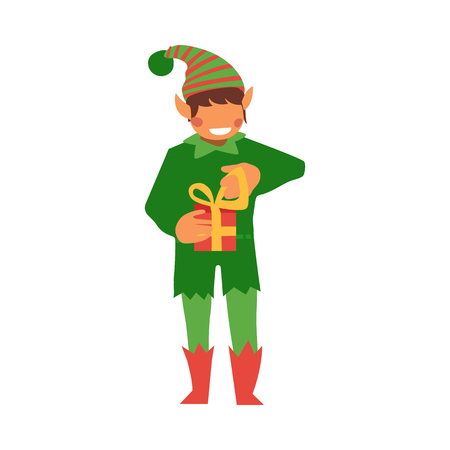 vector flat christmas elf boy holding present box with golden ribbon bow smiling. Fairy holiday character in hat, green costume, santa claus magic assistant. Isolated illustration