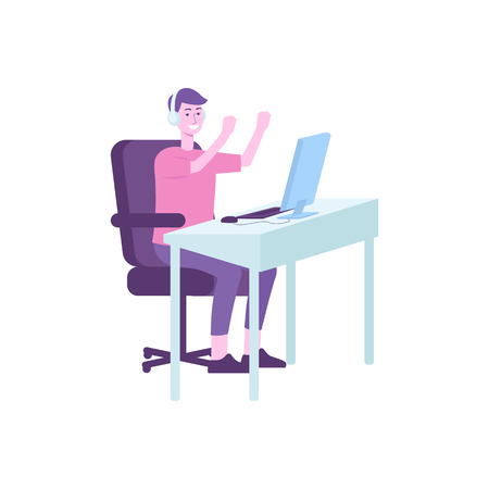 Happy gamer sitting behind computer desk and smiling. Cartoon character gaming via pc technology, young man with headphones winning a game, isolated vector illustration on white background.