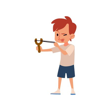 Naughty boy aiming with slingshot with tongue out, cute child with catapult toy making trouble