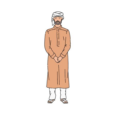 Serious man in Muslim clothes and turban standing straight.
