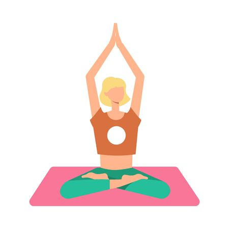 A blond woman is meditating in the lotus position on a yoga mat with legs crossed, arms raised.