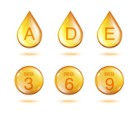 Goldenes Vitamin-Öl-Tropfen-Set - isolierte goldgelbe Tropfen und Kugel der Vitamine A, D, E und Omega 3 6 9 isoliert auf weißem Hintergrund.