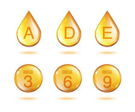 Insieme dorato della goccia dell'olio della vitamina - gocce gialle dell'oro isolate e sfera delle vitamine A, D, E e Omega 3 6 9 isolate su fondo bianco.