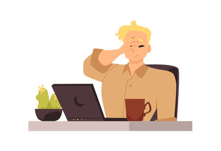 Overworked businessman at the workplace at the laptop is experiencing stress
