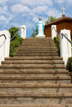 Long stairway leading to virgin Mary outdoors photo