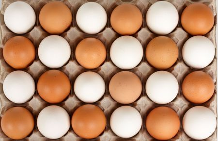 White and brown eggs lying in lattice in staggered order photo