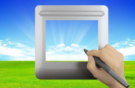 Modern digital tablet with grass and clouds background