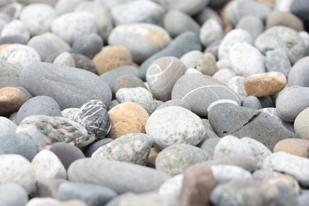 Stones on the see coast with focus in the center