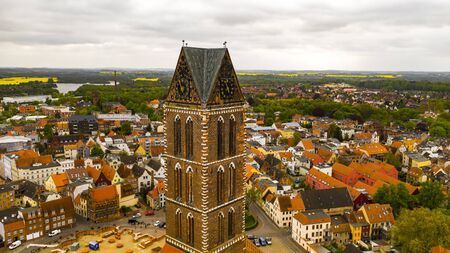 Tower of St. Mary, Gothic brick building, 14th century, Wismar, Mecklenburg-Western Pomerania, Germany, aerial shooting, beautiful landscape Banco de Imagens - 138230924