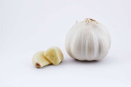 sectioned: Garlic bulb and sectioned clove on white