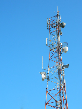 gsm: Communication Tower with Parabolic and GSM Antennas LTE and perfect Blue Sky. Stock Photo