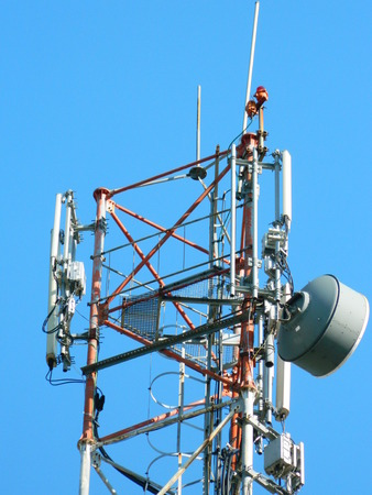 lte: Communication Tower with Parabolic and GSM Antennas LTE and Blue Sky close up