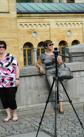 point and shoot: Amateur photographer uses professional tripod for small white point and shoot camera.