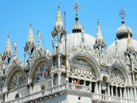st mark's square: Closeup of the Patriarchal Cathedral Basilica of Saint Mark at the Piazza San Marco - St Marks Square , Venice Italy, with amazing first floor architecture and paintings.