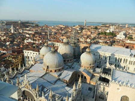 campanille: The roof of the Cathedral of San Marco, Venice , Italy,from Campanille tower with its domes and beautiful sunset.