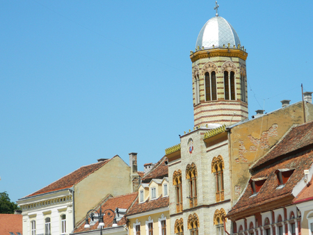 brasov: Synagogue in main town square of Brasov, Romania with its  architectural details and silver dome.