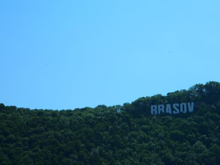 brasov: Brasov sign on top of Tampa hill on a sunny summer day. Stock Photo