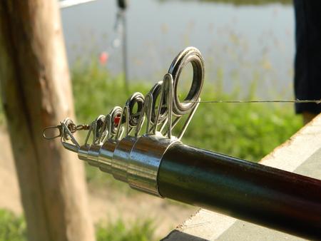 Fishing pole: Fishing pole silver tip of carbon fibre. Stock Photo