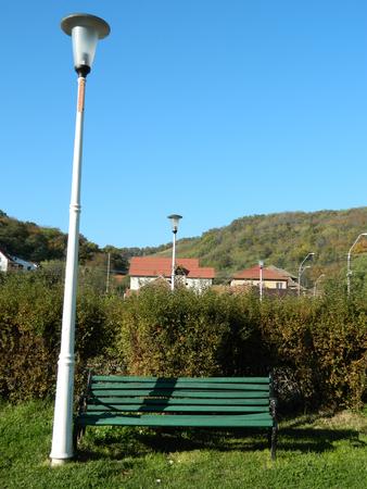 empty bench: Empty bench in autumn park. Stock Photo