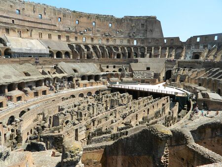 amphitheatre: The Colosseum or Coliseum, also known as the Flavian Amphitheatre, is an oval amphitheatre in the centre of the city of Rome, Italy. Built of concrete and stone, it is the largest amphitheatre ever built and is considered one of the greatest works of arch Stock Photo