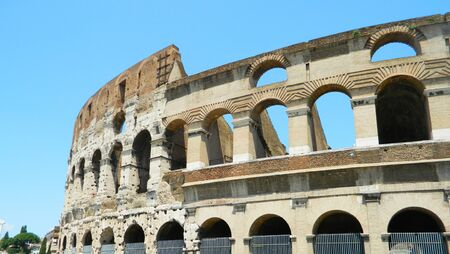 emporium: The Colosseum or Coliseum, also known as the Flavian Amphitheatre, is an oval amphitheatre in the centre of the city of Rome, Italy. Built of concrete and stone, it is the largest amphitheatre ever built and is considered one of the greatest works of arch Stock Photo