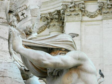 navona: Blindfolded man statue in piazza Navona, fountain of four rivers. Stock Photo
