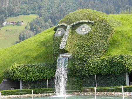 waterspout: Swarovski green man of legend near Innsbruck, Austria, at the main crystal factory.