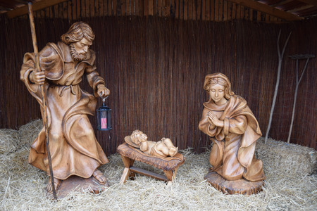 Joseph and Mary with baby Jesus statues at Christmas market, Sibiu, Romania Stock Photo