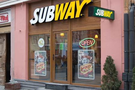 primarily: SIBIU, ROMANIA -NOVEMBER 19, 2014: Subway is an American fast food restaurant franchise that primarily sells submarine sandwiches and salads. Editorial
