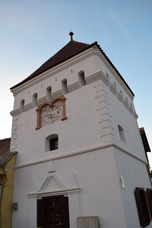Renovated Fortress Tower at sunset in Medias, Romania.