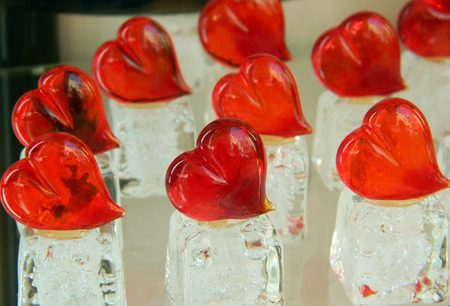 Valentines day hearts made of Murano glass, on white, ice like support. Stock Photo