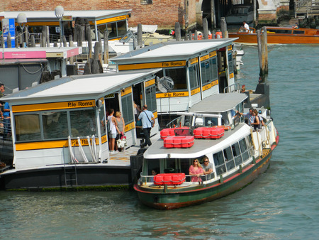 VENICE, ITALY - 6 JULY 2015 Venice vaporetto station fulll of tourists.