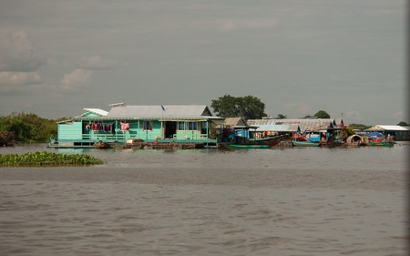 building of a floating village on the tonle sap close to siem reap in cambodia
