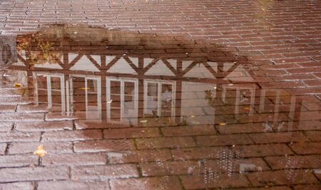 Water reflection of a half-timbered house