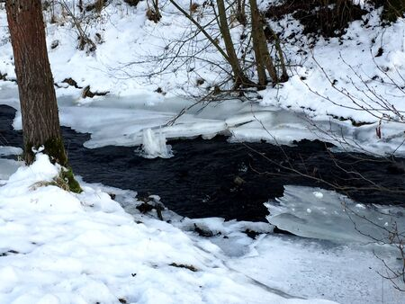 a creek in winter in the Eifel Stock Photo