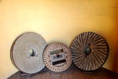 three different millstones of a windmill 스톡 콘텐츠 - 130065241
