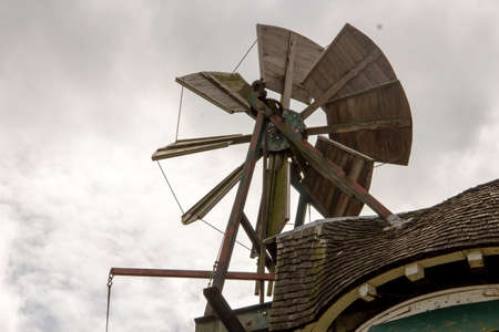 view of a windmill with its large drive shaft and the windmill vane Zdjęcie Seryjne