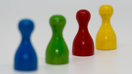 Pawns blue green red yellow Stock Photo