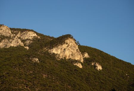 Mountain range and steet face and blue sky