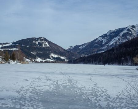 Frozen lake with mountains in the background Stok Fotoğraf