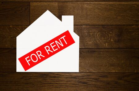 house for rent: House for rent over wooden background